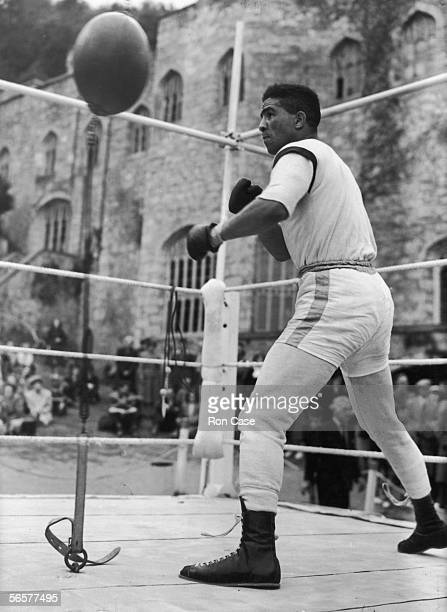 British middleweight boxing champion Randolph Turpin trains with a punchball outside Gwrych Castle Abergele North Wales for his title fight against...