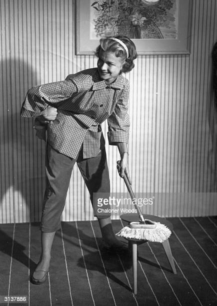 A housewife doing the dusting