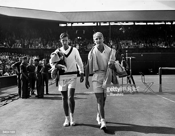Lew Hoad of Australia and T T Fancutt of South Africa walking off court at the Wimbledon Lawn Tennis Championships Lew Hoad won 97 63 75