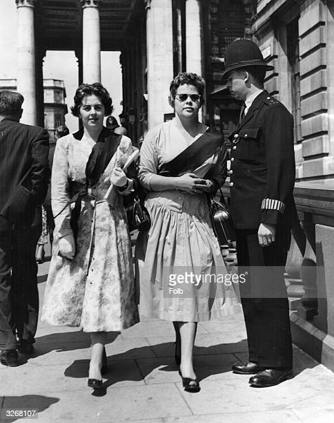 Miss Betty Boothroyd and Miss Joan Richardson wearing black sashes when they visited South Africa House in support of the Movement for Colonial...