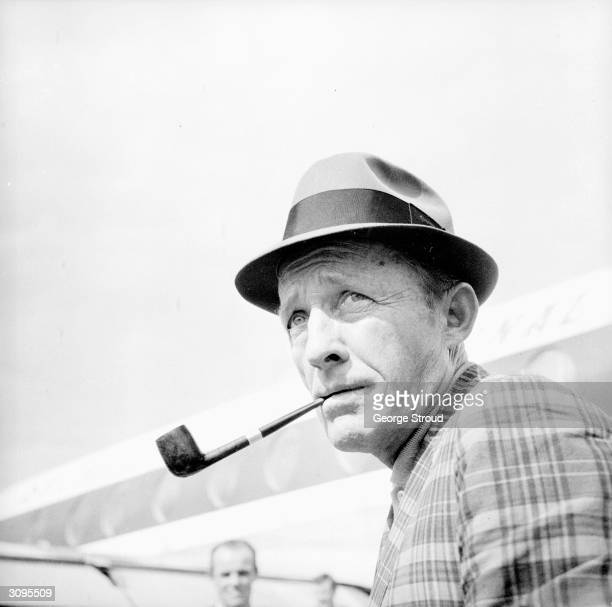 American actor and singer Bing Crosby arrives at London Airport after a trip to Dublin