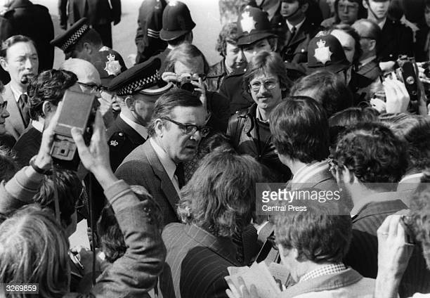 Former Labour Secretary of State for Northern Ireland Merlyn Rees talking to pickets outside the Grunwick photoprocessing Laboratory in Willesden...
