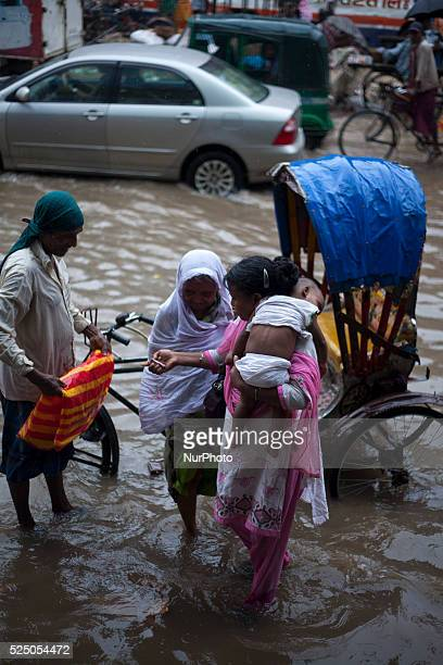 in Dhaka on 27th June 2015Heavy raining in the city continued for a four consecutive day inflicting endless suffering on the people as water logging...