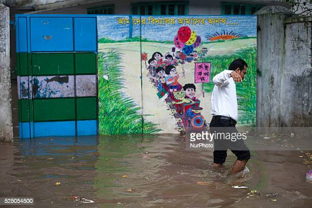 People walking on waterlogged street during rain in Dhaka on 27th June 2015Heavy raining in the city continued for a four consecutive day inflicting...