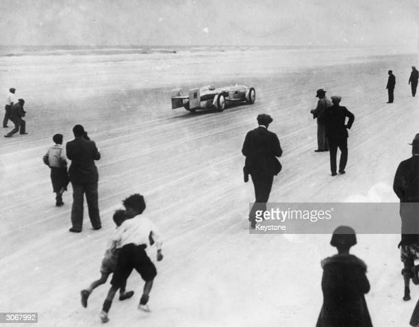 British racing driver Kaye Don takes the Silver Bullet on a trial run at Daytona Beach Florida before an attempt to establish a new land speed record...
