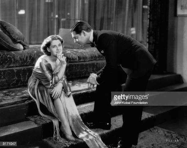 Norma Shearer as Jan Ashe and Clark Gable as mobster Ace Wilfong in a scene from 'A Free Soul' directed by Clarence Brown Costumes by Adrian