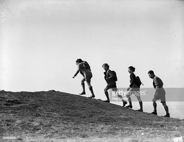 Hikers walking up Dunstable Downs in Hertfordshire.