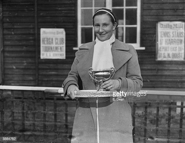 British tennis player Dorothy Round with the cup after her victory over Mary Heeley in the women's singles final at the Herga Club's Tennis...