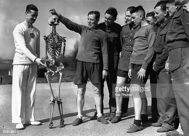 Soldiers attend a lecture on the human body with the aid of a skeleton as part of their training at the London Area School of Physical and...