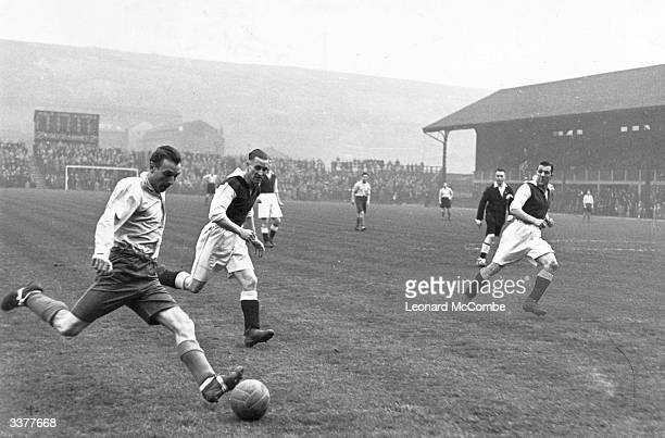Footballing hero and wartime corporal with the RAF Stanley Matthews runs with the ball on the right wing for the RAF team Original Publication...