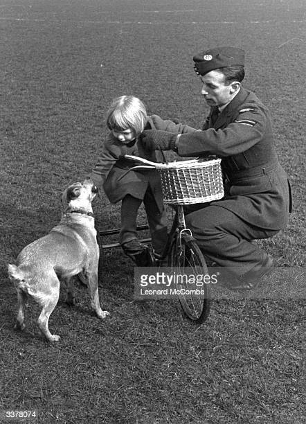 RAF corporal and football star Stanley Matthews takes his daughter and the dog for a cycle on a deserted football pitch Original Publication Picture...
