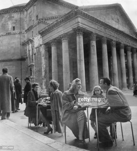 Writer Franz Treuberg drinking at an outdoor cafe in Rome with actress Lilo Meessen and her daughter The two are collaborating with Italian director...