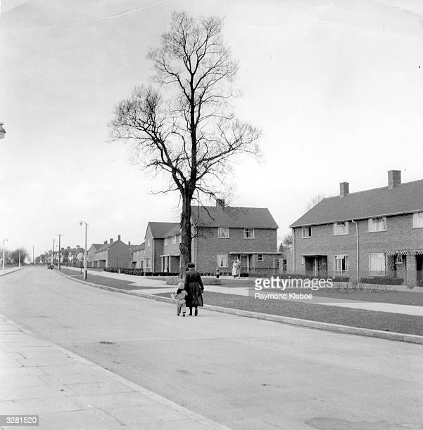 A couple of mothers with their children can be spotted among the expanse of council houses in the new town of Hemel Hempstead Hertforshire Original...