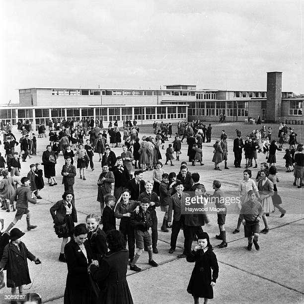 Children crowding the playground of a school in English New Town Hemel Hempstead Original Publication Picture Post 7094 The Best And Worst Of Britain...
