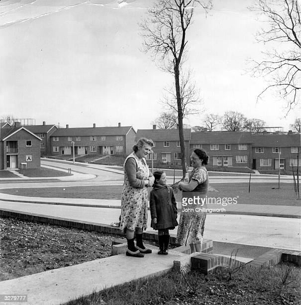 Two women and a child chat in the garden of a Council house in the new town of Hemel Hempstead Hertfordshire Original Publication Picture Post 7094...