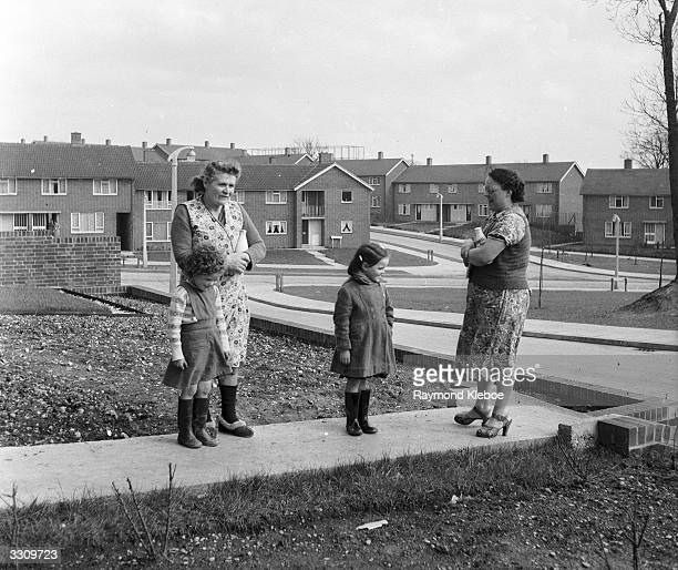 Two women and their children talking in a street of council housing in the new town of Hemel Hempstead Hertfordshire Original Publication Picture...
