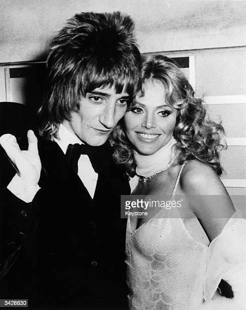 Rod Stewart and Britt Ekland attending the film premiere of Ken Russell's film of Pete Townshend's rock opera 'Tommy'