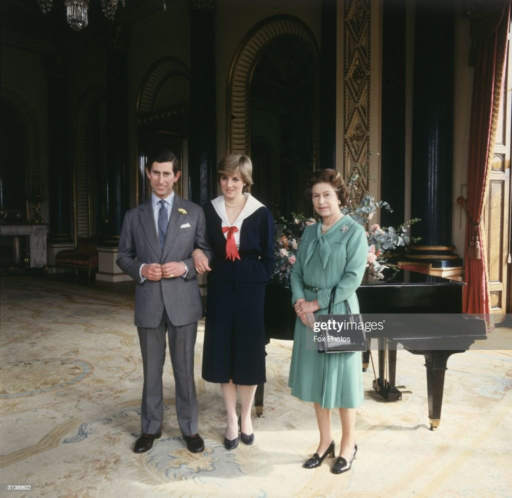Queen Elizabeth II of Great Britain with Prince Charles and Lady Diana Spencer at Buckingham Palace.