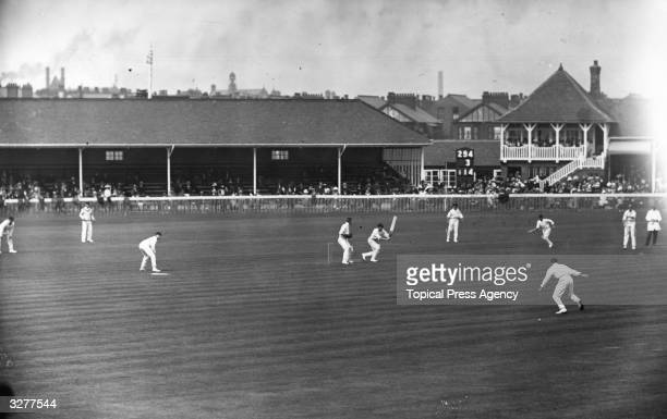 Australian cricketer Warren Bardsley batting scoring a boundary and Sydney Edward Gregory running during the match between South Africa and Australia...
