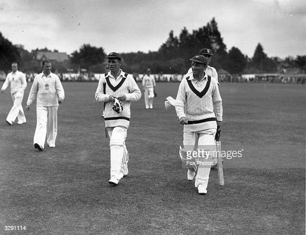 Australian cricketer Don Bradman , , leaves the pitch at Southampton after completing 1,000 runs, the first player of the season to achieve this...
