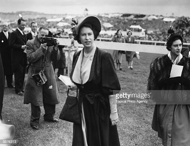 Princess Elizabeth later Queen Elizabeth II of Great Britain and Princess Margaret at the Epsom Racecourse during the Derby