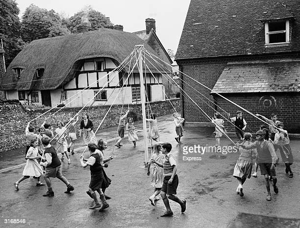 Children of Cheriton village school in Somerset rehearsing a maypole dance to celebrate the coronation of Elizabeth II