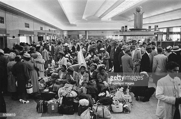 Crowd of 700 West Indian immigrants in the customs hall at Southampton. Original Publication: Picture Post - 8405 - Thirty Thousand Colour Problems -...