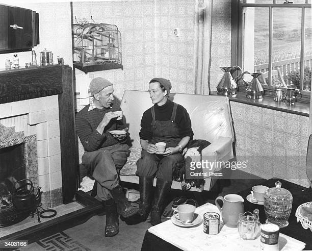 Bert and Ella Wheeler lighthouse keepers on the Isle of Walney off BarrowInFurness enjoying a well earned rest and a cup of tea