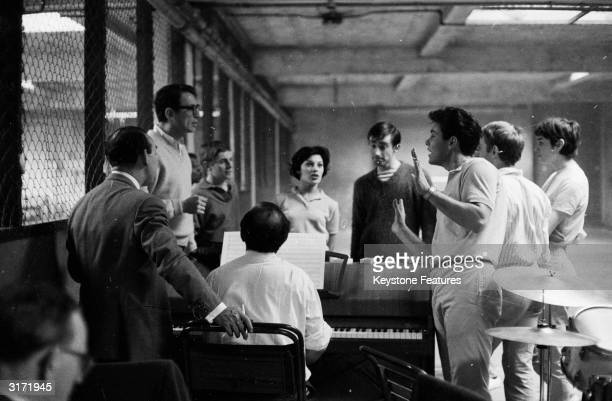 The cast of 'The Young Ones', directed by Sidney J Furie discuss dance routines during rehearsals in a hall in London, before the start of filming....