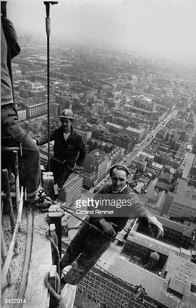 Two workmen suspended from the Post Office Tower London during its construction
