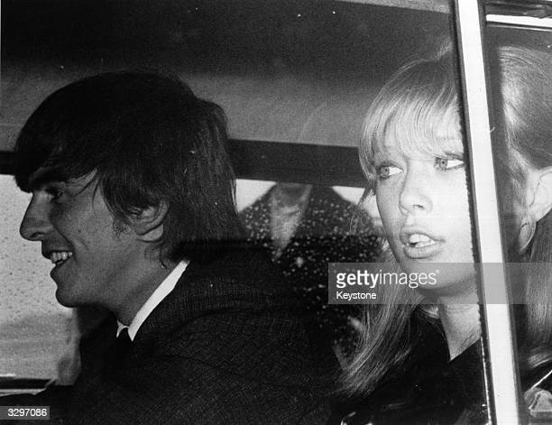 George Harrison of the pop group The Beatles and his girlfriend Patti Boyd arrive back in Britain after a monthlong holiday on an island in the South...