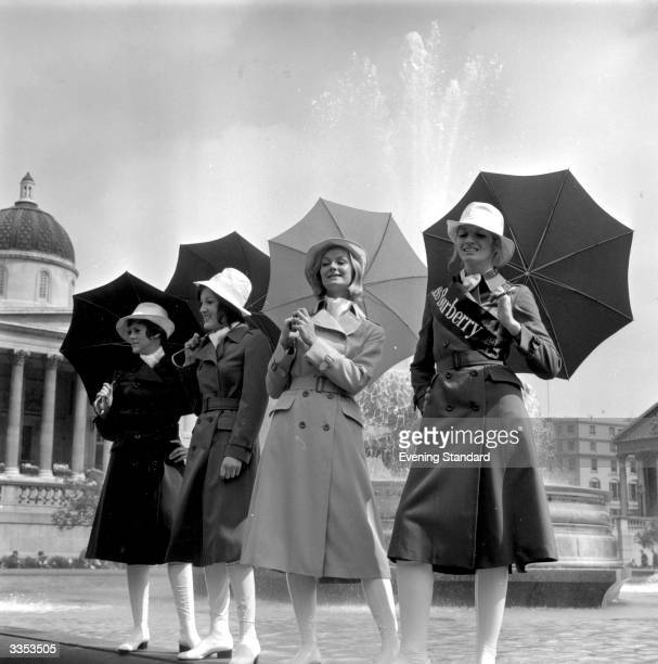 Brenda Capwell this year's 'Miss Burberry' poses in London's Trafalgar Square with three other models in Burberry fashions