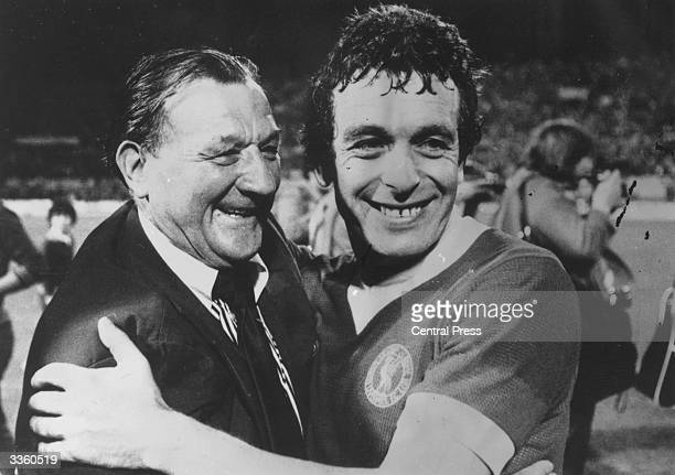 Liverpool football club manager Bob Paisley embraces player Ian Callaghan after the final of the European Cup in which Liverpool beat Borussia...