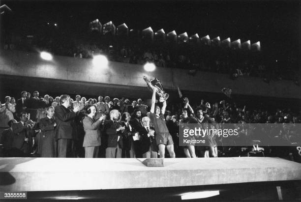 Liverpool captain Phil Thompson holds the European Cup aloft in victory after his side's 10 victory over the Spanish team Real Madrid in the European...