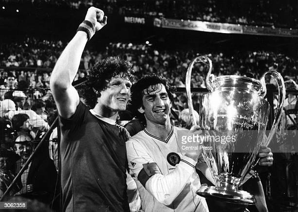 Aston Villa footballers Allan Evans and Dennis Mortimer with the European Cup after their team beat Bayern Munich 1 0 in Rotterdam