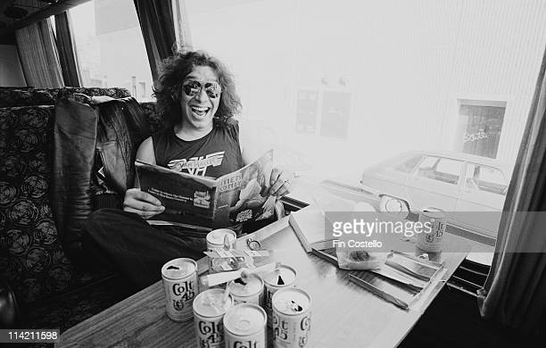 Alex Van Halen from Van Halen reads a magazine on their tour bus outside Lewisham Odeon in London on 27th May 1978