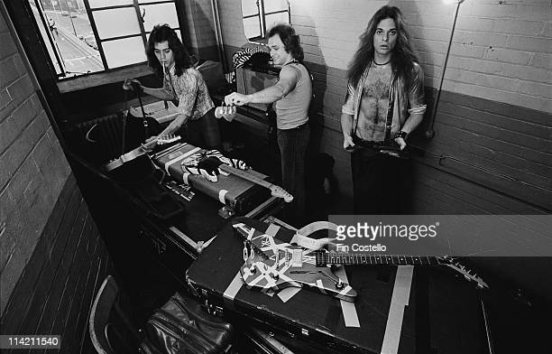Members of the Rock band Van Halen pose backstage at Lewisham Odeon in London on 27th May 1978 Left to Right Eddie Van Halen Michael Anthony David...