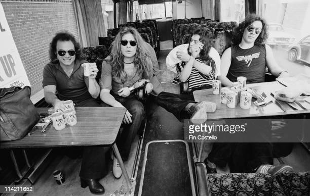 Van Halen pose in their their tour bus outside Lewisham Odeon in London on 27th May 1978 On the table in front of the band are various beer cans and...