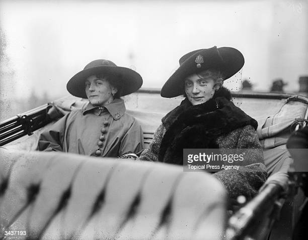Two French munitions workers take a tour of London by car