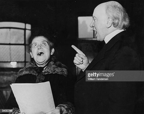 The Reverend Herbert Dunnico rehearsing carol singing with the eighty four year old Mary Staples at the Grandmothers Club at the Browning Settlement...