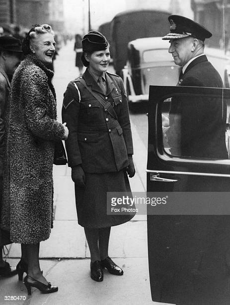 Wife of the Premier Mrs Churchill and her daughter Mary with the First Sea Lord Sir Dudley Pound Mary was a Lance Corporal in the ATS