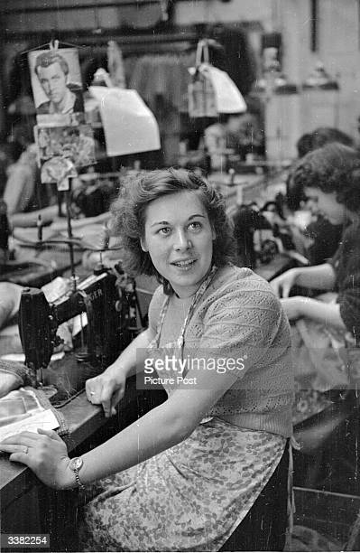Year old Mrs Evelyn Makepiece works on an assembly line in a clothing factory in Leicester. Evelyn has been selected by Picture Post as proof of the...