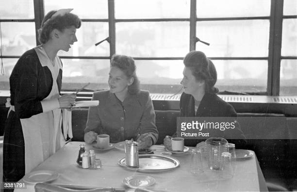 Waitress take an order in the restaurant of Lewis's department store in Leicester. Original Publication: Picture Post - 4670 - Is It True What They...