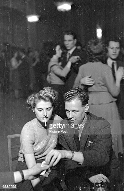 Joyce Taylor, a beautician at Lewis' department store enjoys a night out at one of Leicester's dance halls with her boyfriend Noel Waring. Joyce was...