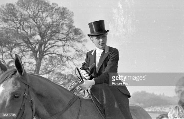 Mrs George Earle of Bargrave Hall near Leicester takes her camera out with Quorn hunt. Original Publication: Picture Post - 4670 - Is It True What...