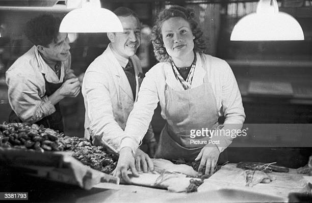 Mrs Jean Maughn, housewife and part time assistant on a fish and rabbit stall at Leicester fish market. Jean has been selected by Picture Post as...