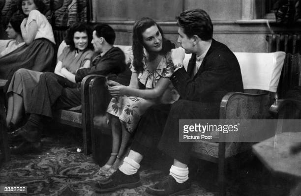 Young couples sitting out a dance at the Bell Hotel in Leicester. Original Publication: Picture Post - 4670 - Is It True What They Say About...