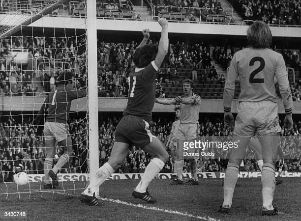 The Burnley footballer Keith Newton watches as the Chelsea player Ken Swain celebrates after Chelsea go ahead against Burnley