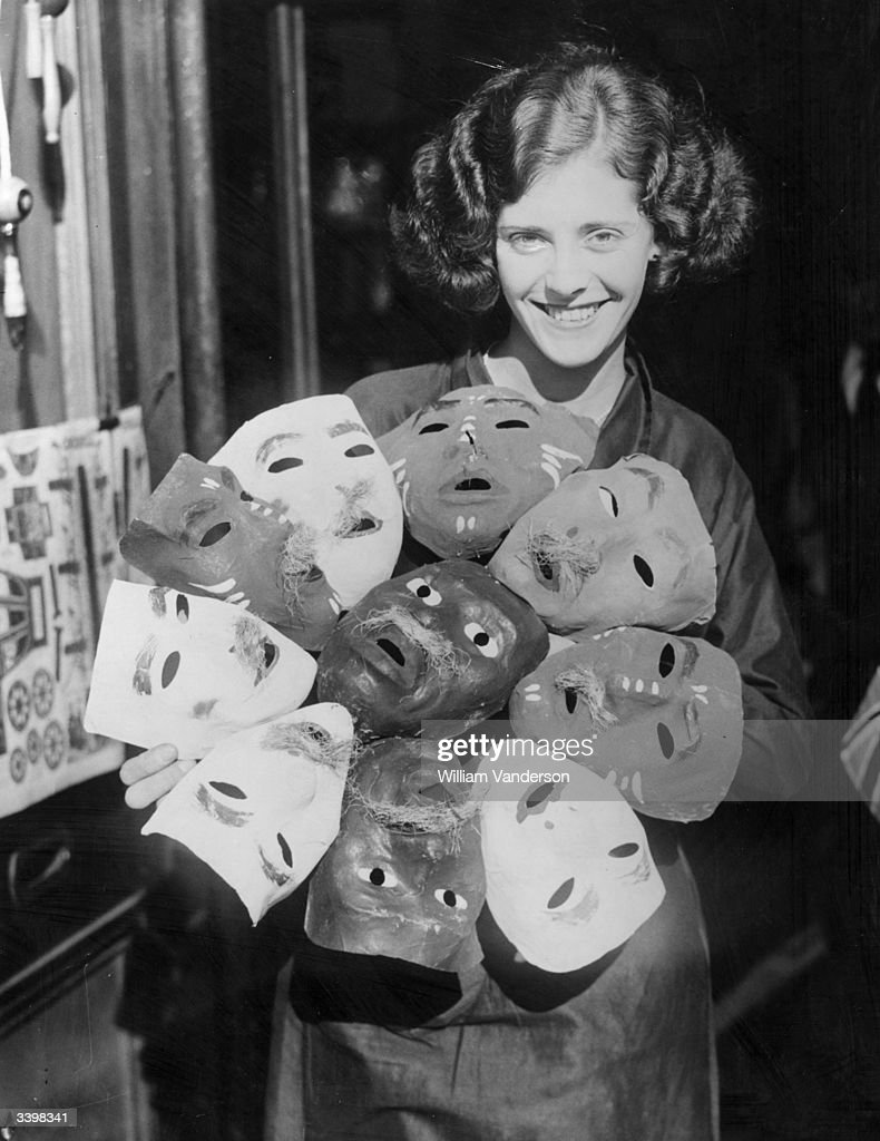 An assistant at a shop in Slough, Berkshire, with a selection of Guy Fawkes masks.