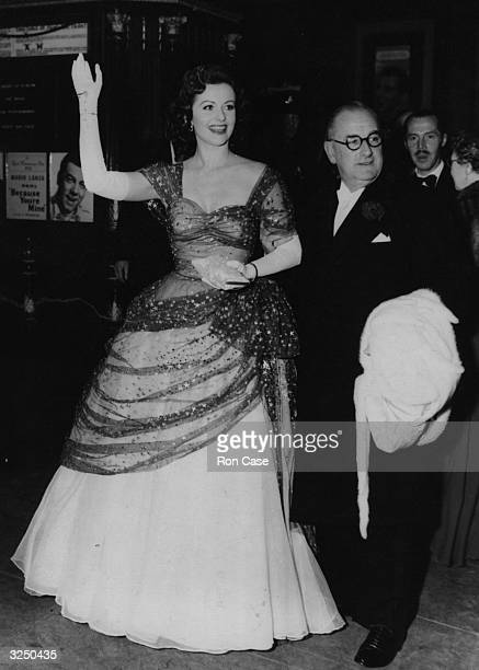 Margaret Lockwood escorted by Herbert Wilcox as they arrive at the Empire Leicester Square